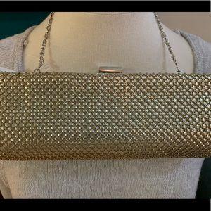 Gold mesh clutch bag
